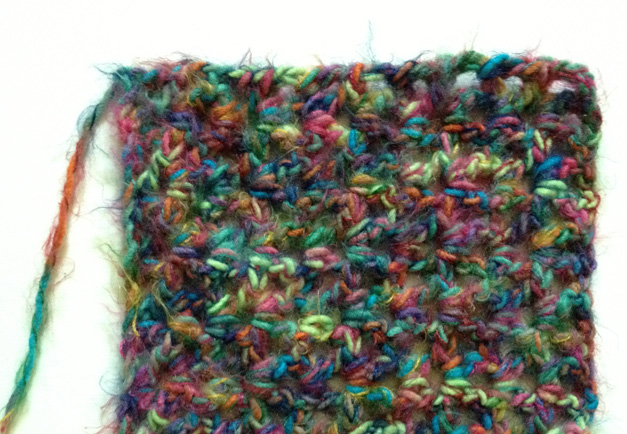 First few rows of multicolored throw.